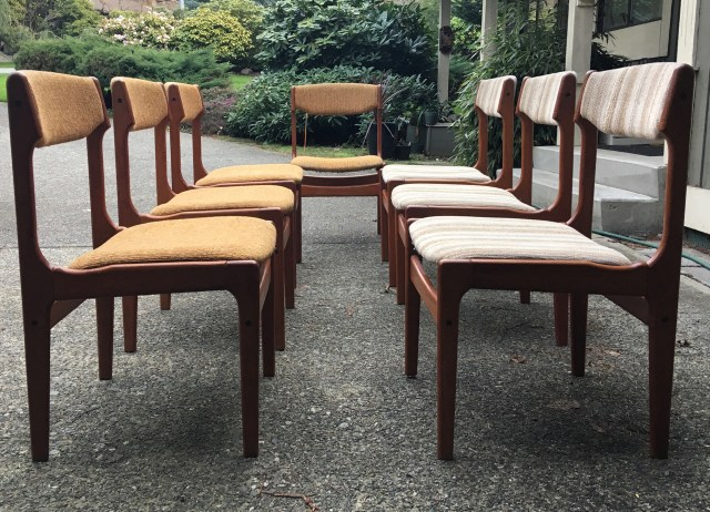 Seven teaky chairs with the 1970's all over the seats.