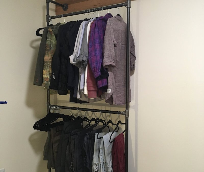 Build an open closet out of gas pipe