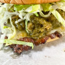 Roswell Burger: Vermont Cheddar, Spicy Green Chile Sauce, Grilled Onions, Lettuce