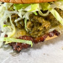 Roswell Burger: New Mexico Style Green Chile Sauce, Cheddar, Bacon Fat Grilled Onions, Lettuce