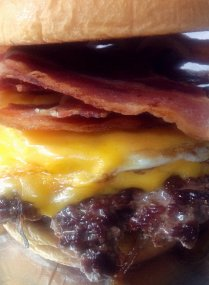 The Ron Swanson Burger: Seared Black Angus Beef, Cheddar, Organic Fried Egg, Extra Bacon (nitrate-free).