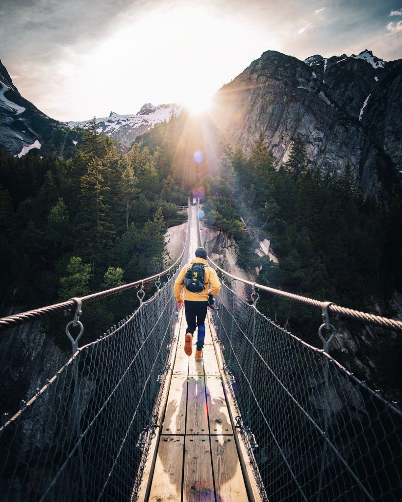 We were at this beautiful brige in murren , in the bernese Oberlan in switzerland with some friend, when i tell my friend to run like if he would catch the last ray.