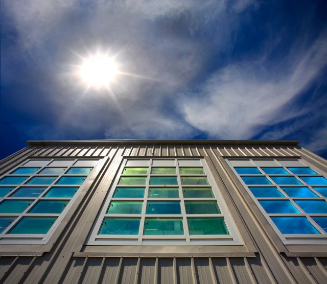 Large paned windows and blue sky with sun