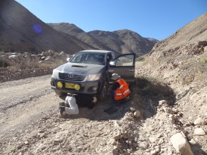 Changing a flat tire off road in the Andes. Photo source: Anna Bidgood