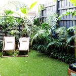 Small courtyard garden with seating area design and layout 16