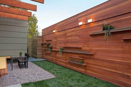 Stunning Creative Fence Ideas for Your Home Yard 34