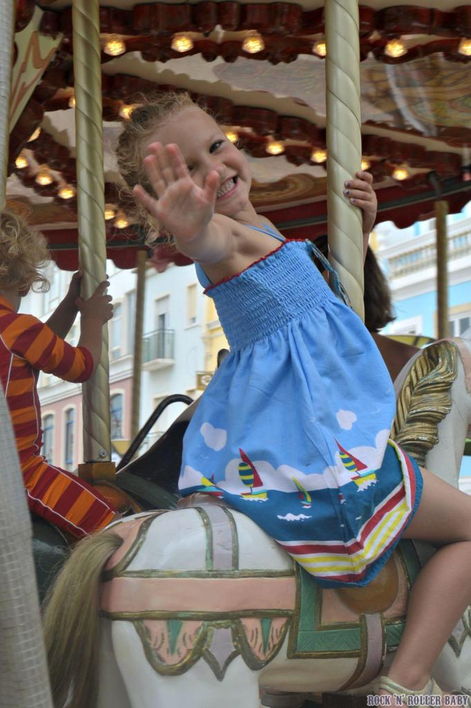 The old fashioned carousel in Lagos town centre - a highlight for the tiny two!