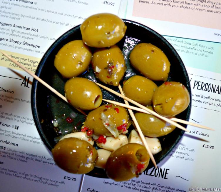 Olives Marinate: Marinated green pitted olives with garlic cloves and pink peppercorns