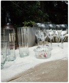 I love the beach theme of this wedding. We used fine white sand on the drink table to give a beachside feel with out being tacky.