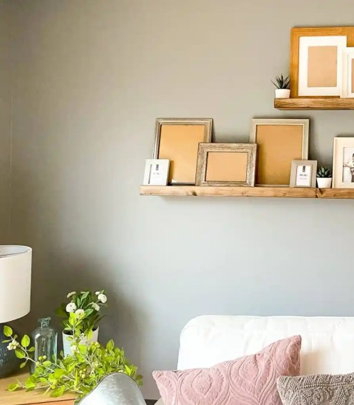 Effortlessly make these wood floating shelves for picture frames for only $20! Picture shelves are easy to make for any space in your home.