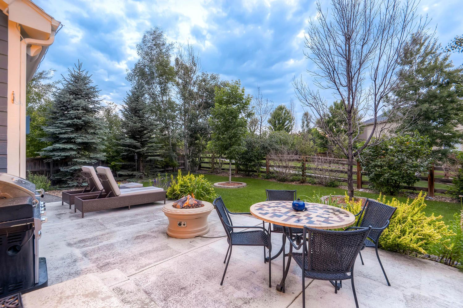 Gorgeous professionally landscaped backyard with views, charm and abundant greenery. Also includes an over sized stamped concrete patio