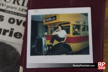 Young  Rosie Glover posing infront a school bus