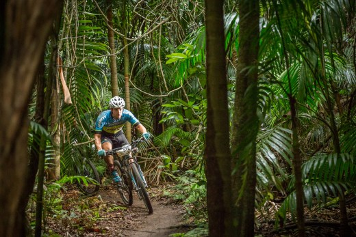 Sam Moffitt in the dense Olney State Forest at Awaba MTB Park.