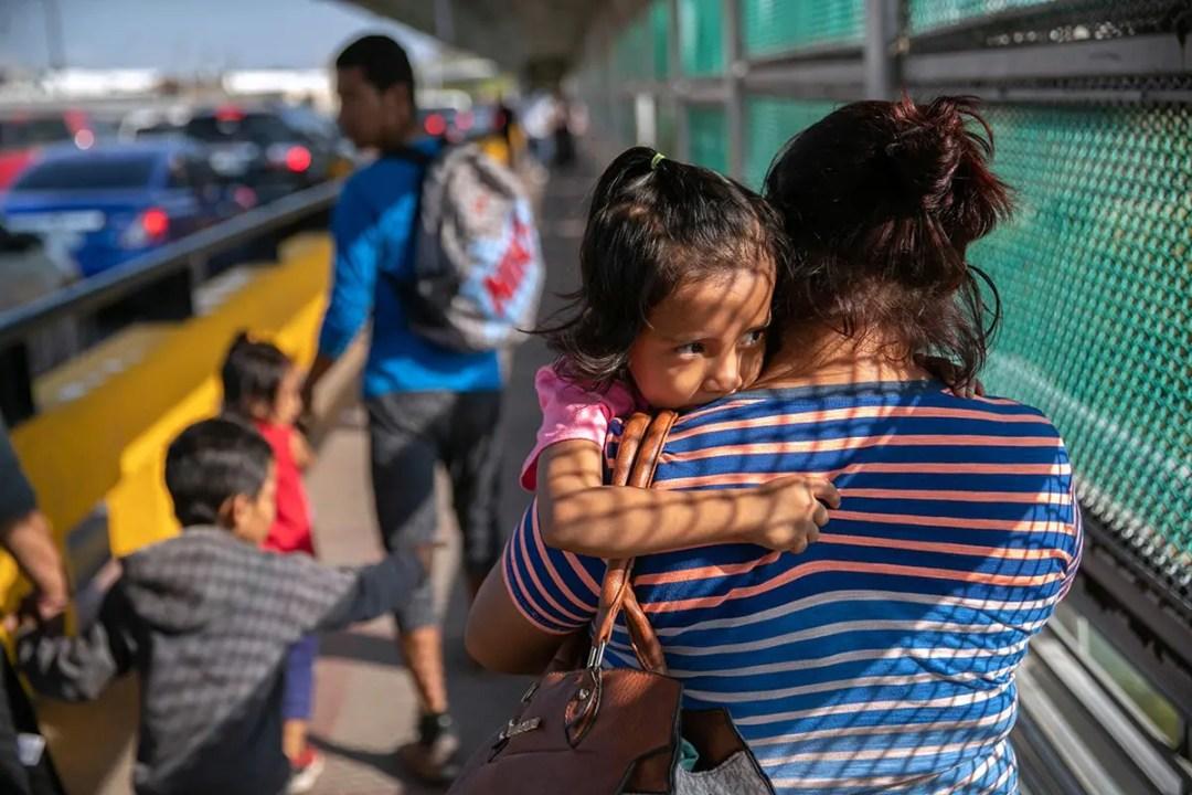 Asylum seeker holding child