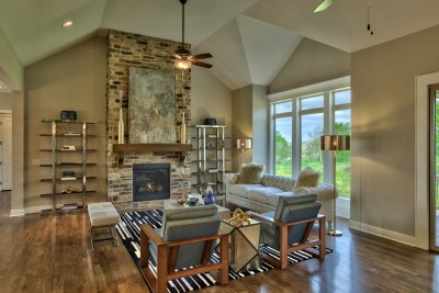 anthem reverse great room with floor to ceiling stone fireplace