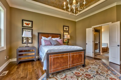 El Dorado master bedroom with painted ceiling