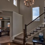 Irving entry and stairs with wood spindles