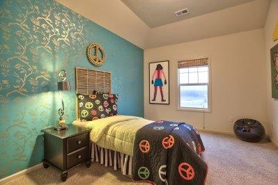 Larsen II secondary bedroom with blue wallpaper