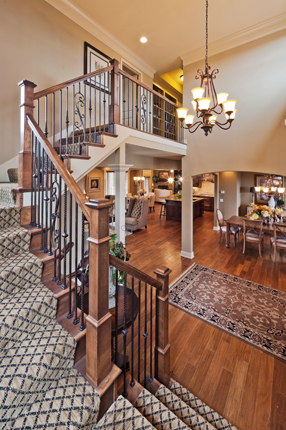 Faux iron spindles in the entry of the Larsen II floor plan by Rodrock homes