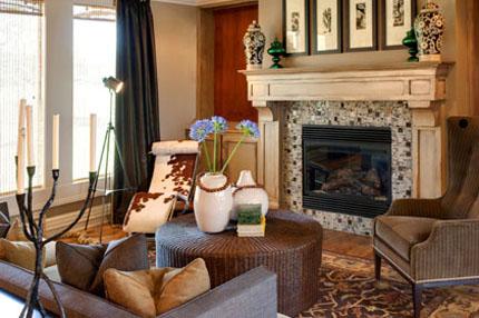 Great room with custom tile on fireplace in the Larsen II floor plan by Rodrock homes