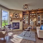 Larsen EX hearth room fireplace with stone wall
