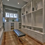 Master bedroom closet with pull down hanging racks