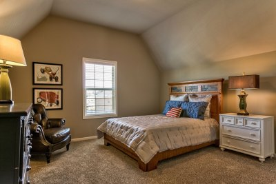 Weston III master bedroom with angled ceiling