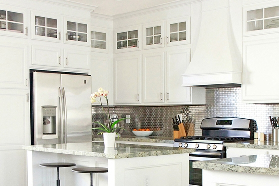 White kitchen with metal backsplash
