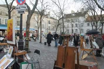 Plaza con artistas