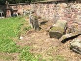 Headstones from graves that were reused.