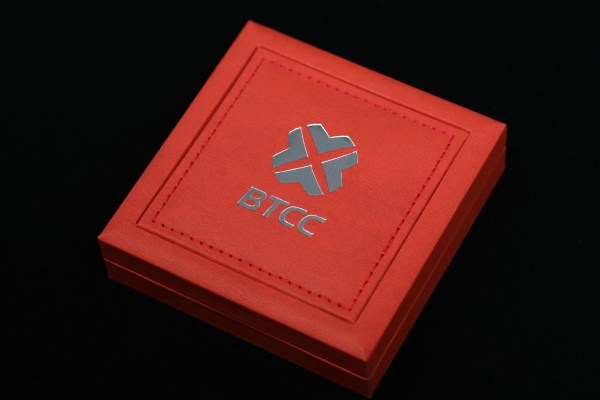 Red edition of BTCC_Mint box for presentation of collectible physical bitcoins.