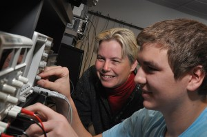 Ann Trausch with a Electronics Student