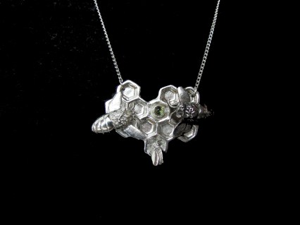 Bees and honeycomb, set with peridot.