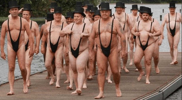 JUDICIAL SPLASH: MEMBERS OF HER MAJESTY'S JUDICIARY ON THEIR ANNUAL EXCURSION TO SKEGNESS.
