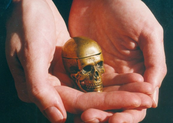 Little Brass Skull with removable cranium and articulated jaw.
