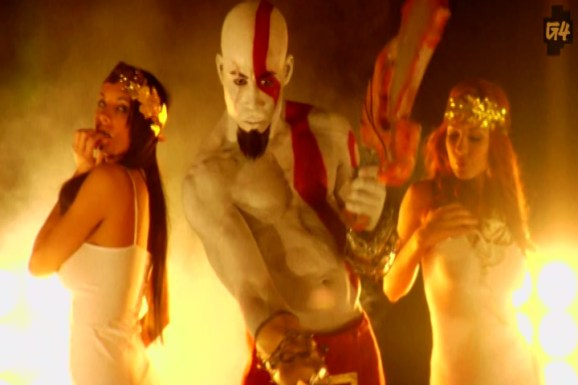 Kratos is trying to put the moves on Jessica Drake from Wicked Entertainment, on the set of G4's Gods Of War music video.