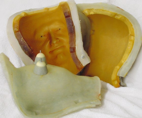 Fiberglass case with urethane jacket two-part head mold. The removable glass core made easy access to the eye sockets from the back.
