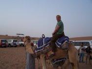 Nick taking a camel ride during our desert safari trip[ in Dubai.