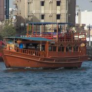 Dhows of Dubai are beautiful old world boats floating down the river. in Dubai.