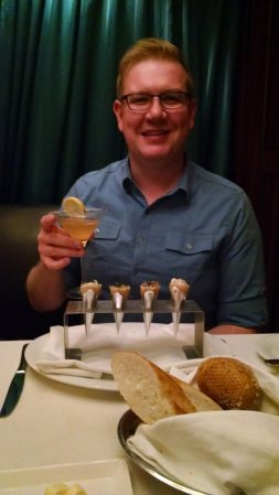 Nick is enjoying his fancy dinner in the Specialty restaurants on one of the many cruises we have taken.