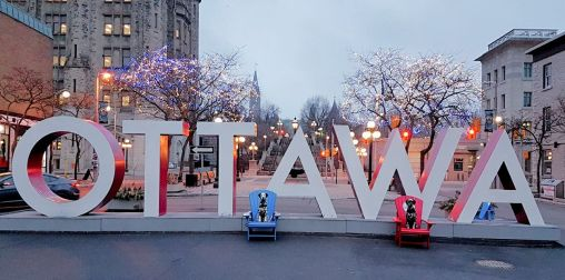 Pet-friendly travels include many roadside attractions for photos like the Ottawa sign.