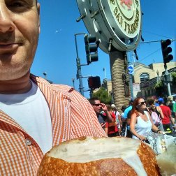 Greg from RogueTrippers is enjoying a bowl of Clam Chowder in a Sourdough bread bowl on Fisherman's wharf in San Francisco.