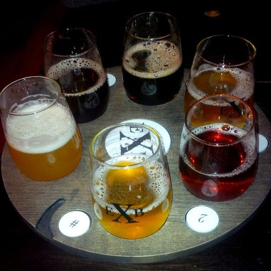 Roguetrippers-enjoying-a-flight-of-craft-beer-at-Exchange-Brewing