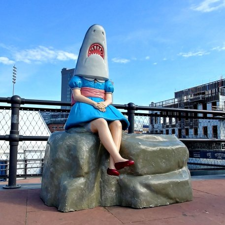 Shark Girl Statue at Canal Side is a Buffalo roadside attraction