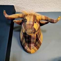 Faux Taxidermy of a Scottish Highland cow was a travel souvenir Roguetrippers bought in Orkney, Scotland