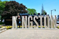 Roguetrippers at the Kingston sign in downtown at the visitor information centre