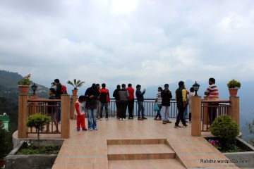 You need to climb steep flights of stairs to reach up from the road level to the circular viewing area.