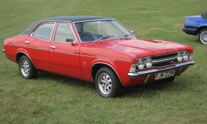Photo of old ford cortina mark 2 in red with a black top