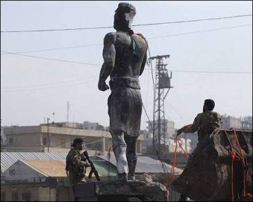 Turkey-fighters-pull-down-Kurdish-Kawa-statue-Afrin-Syria-Mar-18-2018-Reuters
