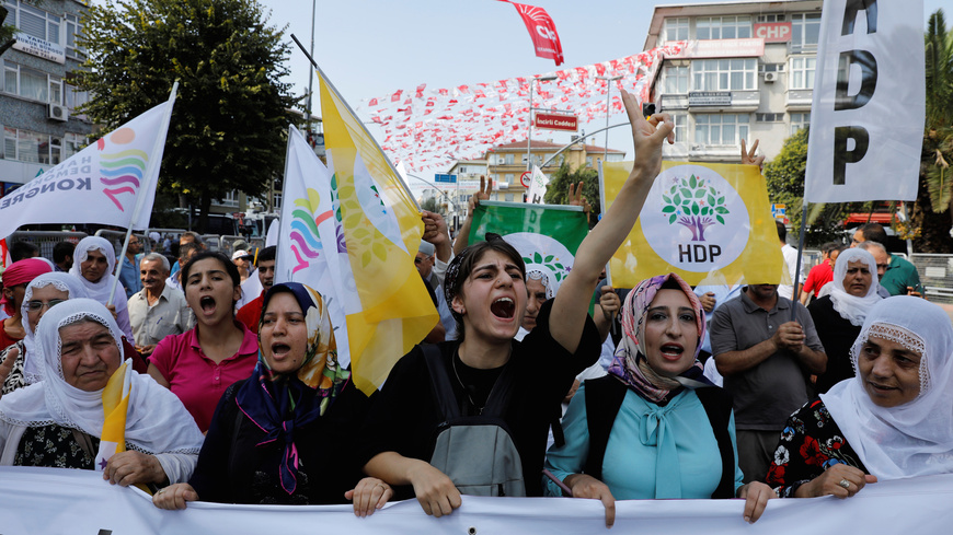Supporters of the Pro-Kurdish Peoples' Democratic Party gather during a rally in Istanbul